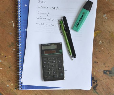 notebook with paper sheets and stationery with calculator